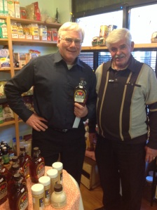 John (left) and Dave show off the Bestemans' maple syrup