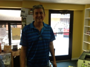 Mark S, Rabbit Food's last ever customer, gets ready to leave the store at 5pm on Saturday, August 8.